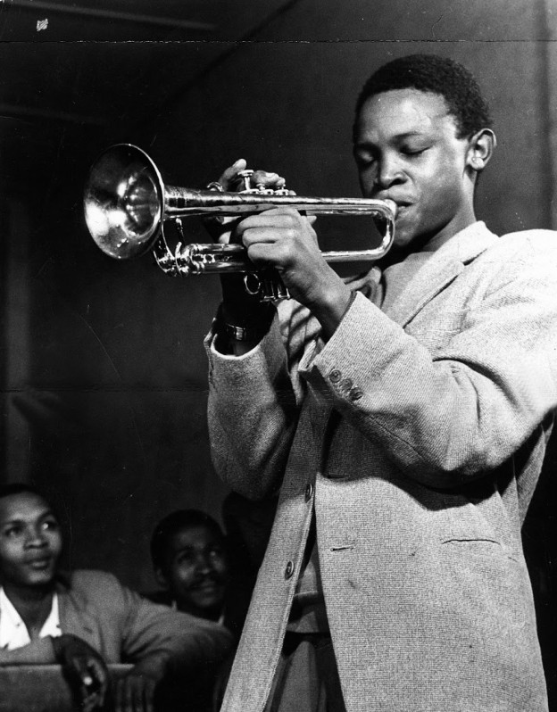 Hugh Masekela playing his Trumpet. Circa 1950's. © Johncom.